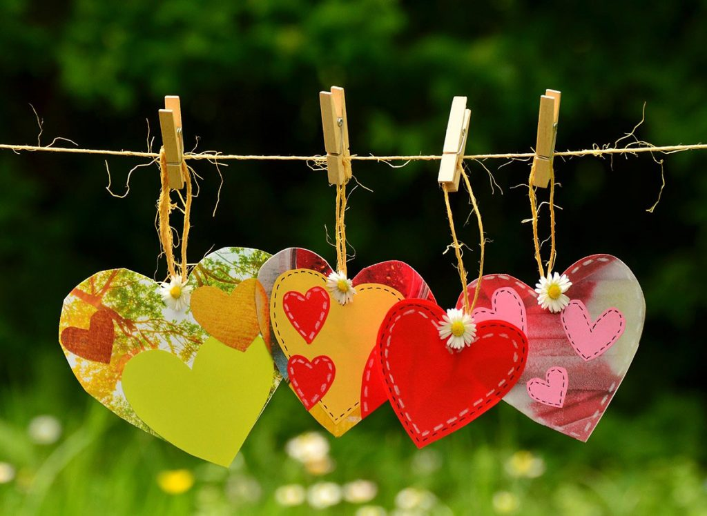 Four brightly colored hearts